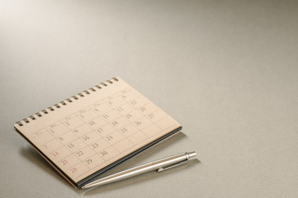 Calendar.Office supply on Blank desk.